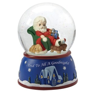 A tired Santa relaxes in a chair inside this musical water globe