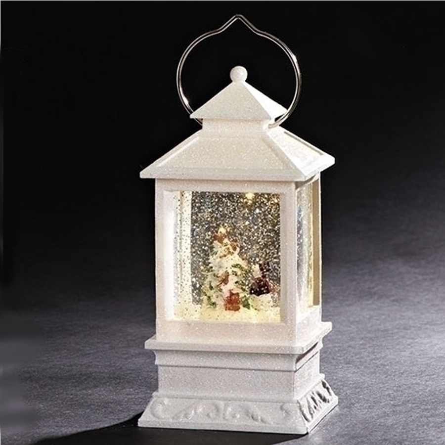 White Christmas lighted lantern. Inside is a snowman and tree with automatic swirl glitter