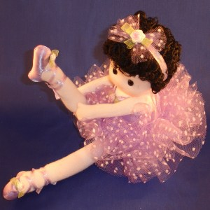 Ballerina in purple musical doll