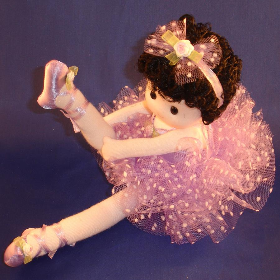 Ballerina in purple musical doll