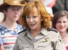 Reba McEntire as Rudy Adair