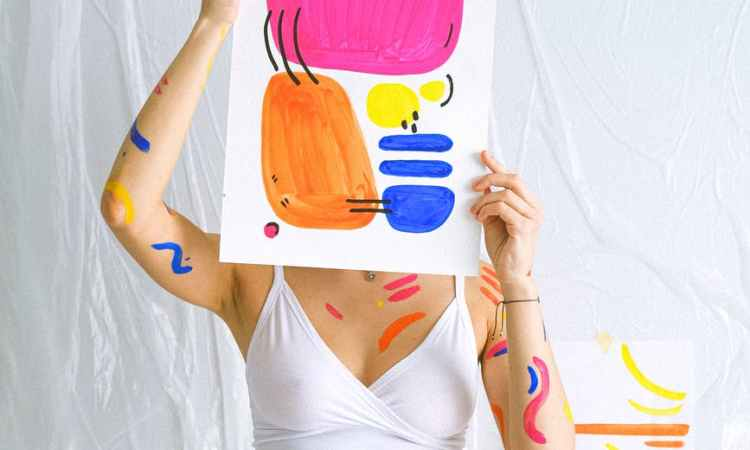 photo of woman holding paint work