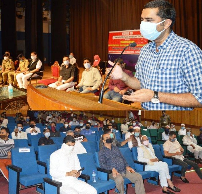 DC Srinagar interacts with transporters, auto-rickshaw operators