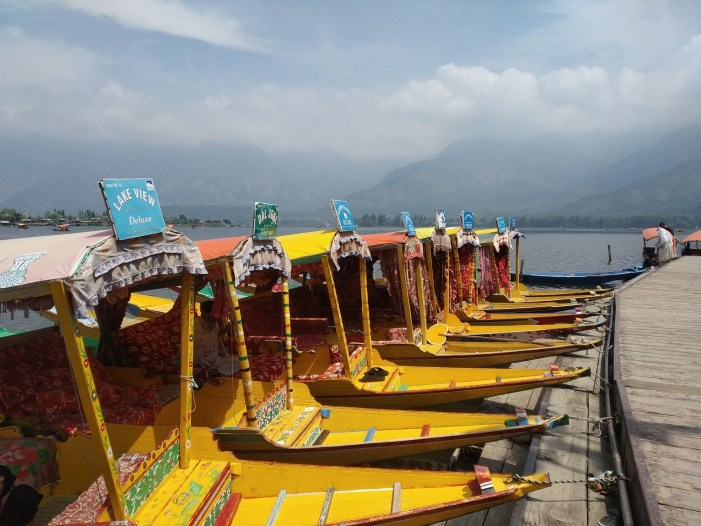 Waiting for tourists hundreds of Shikara Wallas without work on Dal Lake