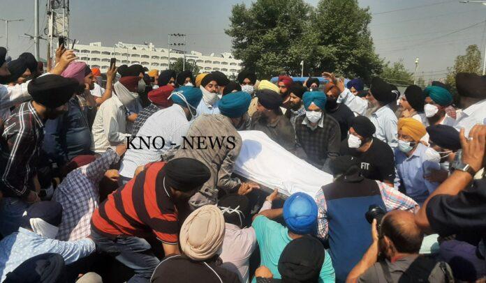 Family members, relatives of slain School principal stage silent sit-in outside Civil Secretariat, Sgr