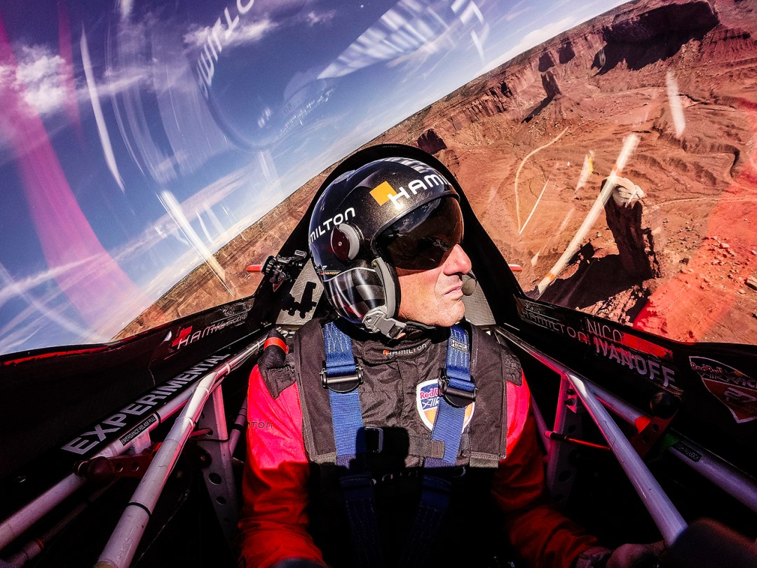 Nicolas Ivanoff of France flies over the Monument Valley Navajo Tribal Park in Utah, United States on September 29, 2015. // Armin Walcher / Red Bull Content Pool // P-20150930-00046 // Usage for editorial use only // Please go to www.redbullcontentpool.com for further information. //