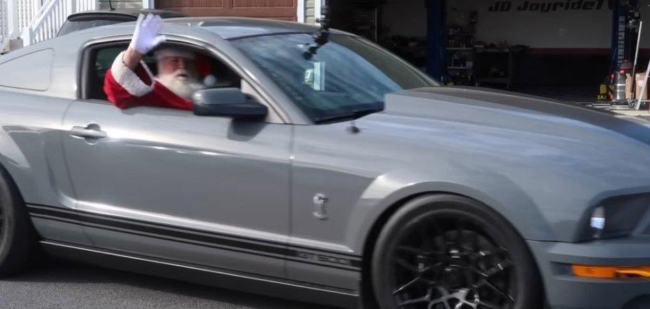 Santa Waving from a GT500 Mustang