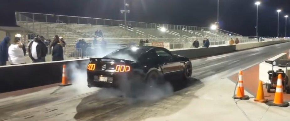 Black Ford Mustang GT Burnout
