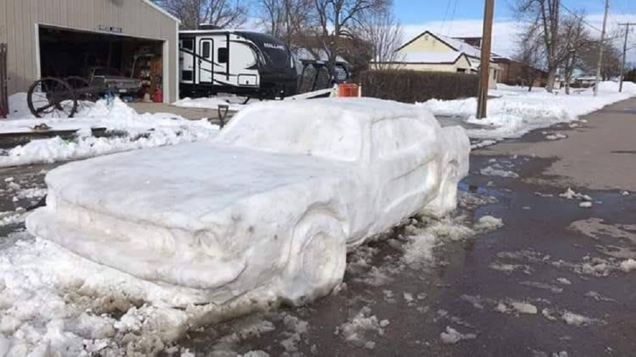 themustangsource.com Nebraska Family Sculpts Snow into a Vintage Ford Mustang