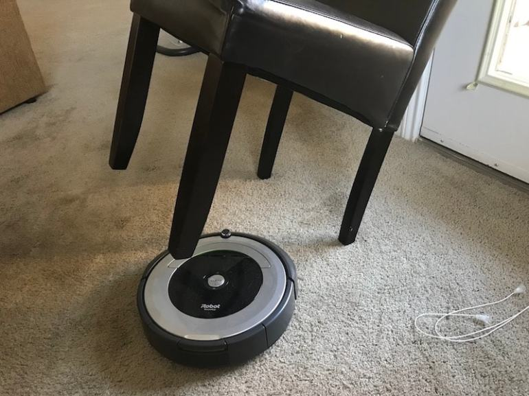 robot vacuum tips showing a leaning chair and allow it to clean under it.