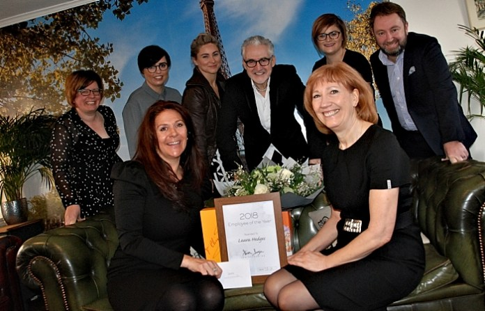 Steven Burgin (centre) with Employee of the Year Laura Hedges, runner up Denise Hartley, salon team members, florist Jacqui O and Joico national sales manager Steve Heaton