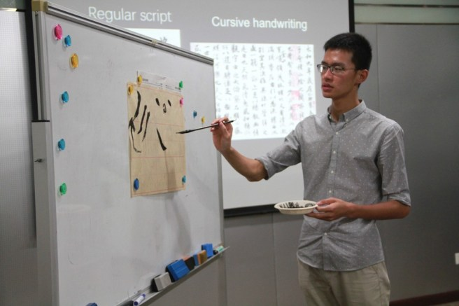 Daniel going over the basic strokes of Chinese calligraphy