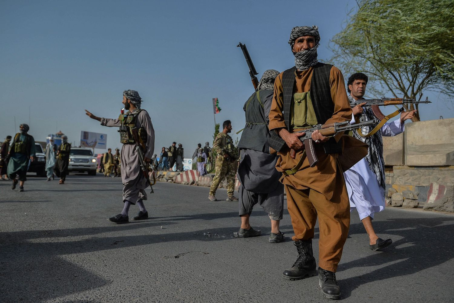 Afghan security personnel and Afghan militia fighting against Taliban, stand guard in Enjil district of Herat province on July 30, 2021. (Photo by Hoshang Hashimi / AFP) (Photo by HOSHANG HASHIMI/AFP via Getty Images)
