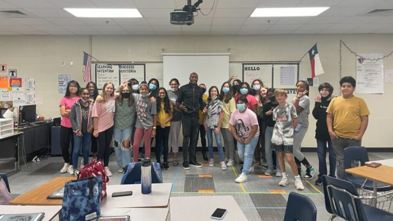 """""""When you look at those kids, you develop a place in your heart for all of them,"""" said Darwin Price (Center), a special education who overcame a troubled childhood to become a boxer, track star and entrepreneur. (Courtesy of Darwin Price)"""