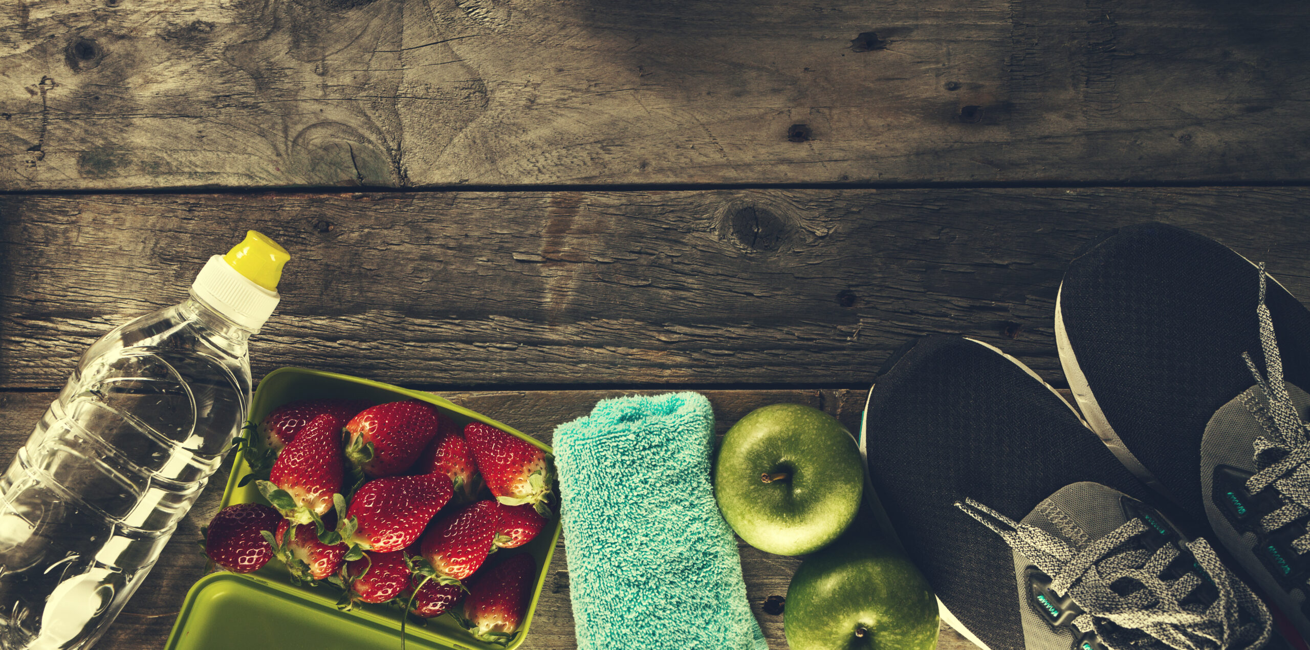 Healthy Life Sport Concept. Sneakers with Apples, Towel and Bott