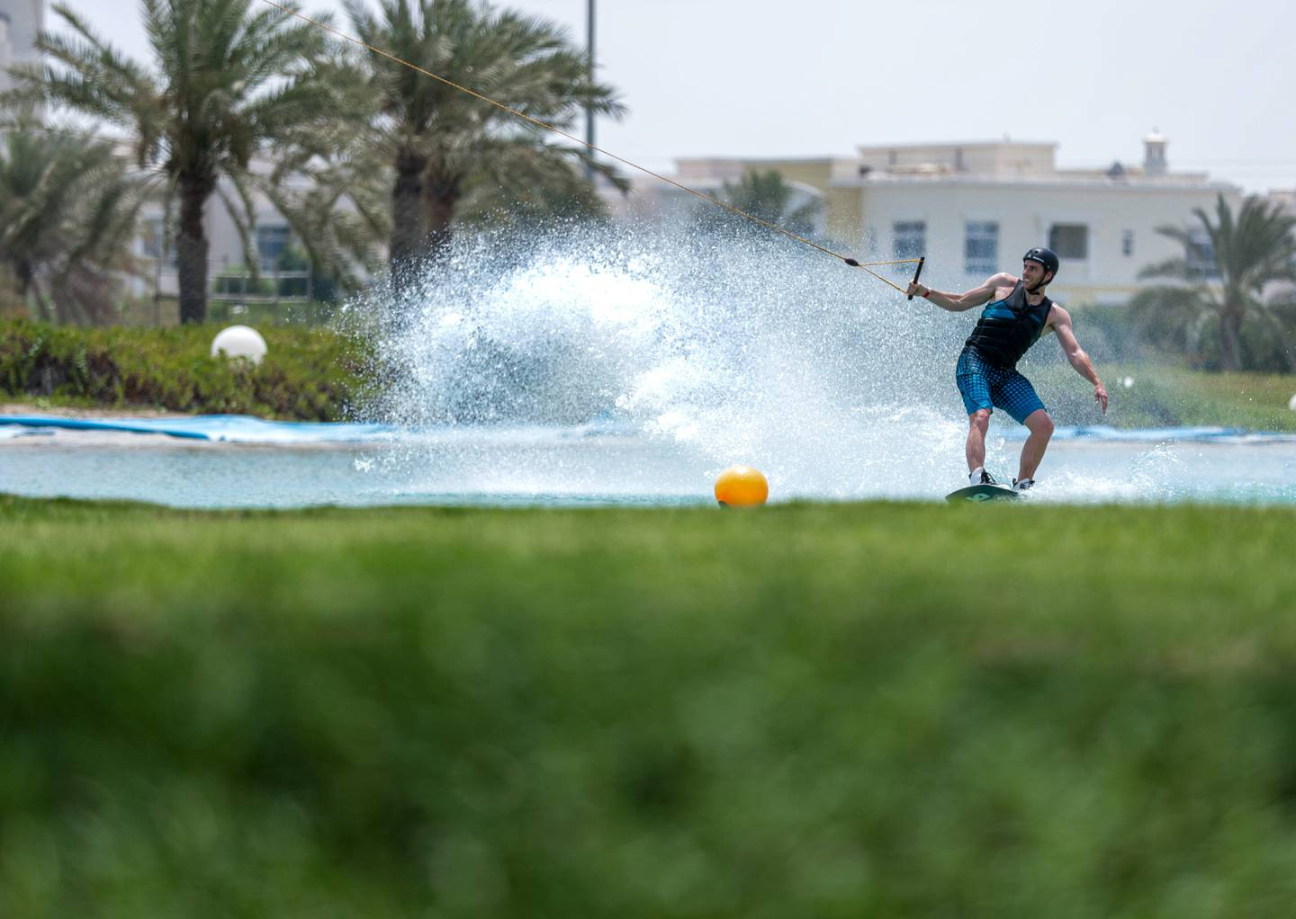 Abu Dhabi, United Arab Emirates, June 21, 2019.  Weather images.  Beating the heat at Al Forsan wakeboarding cable park. --  Rob Dam in action. Victor Besa/The National Section:  NA Reporter: