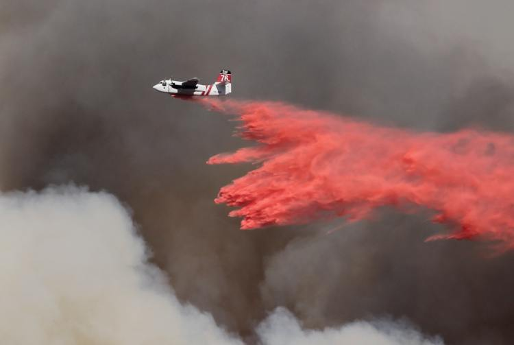 An aircraft dropping retardant on a fire - Klamath National Forest fire season is increasingly challenging.