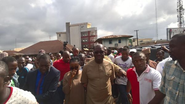 The APC governorship candidate in Edo, Godwin Obaseki, surrounded by supporters after arriving at his polling unit on Wednesday. Photo: Osagie Otabor
