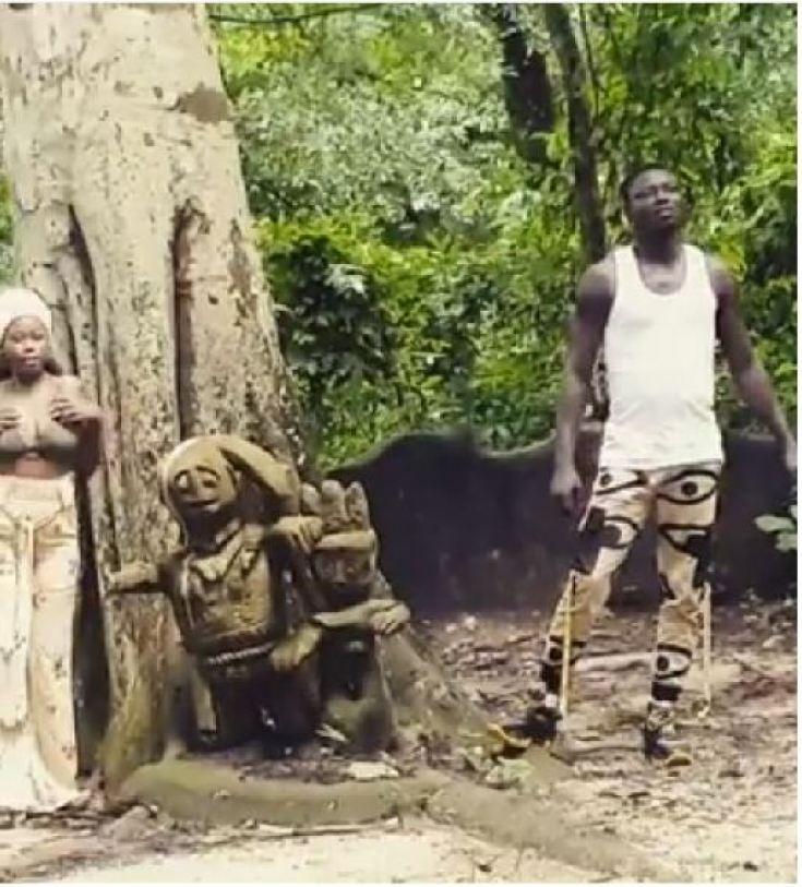 •Jolaoso and his  onscreen partner at  Osun Osogbo grove