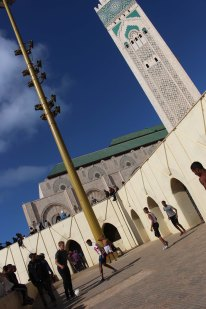 Michael Collett playing soccer football outside of Hassan II Mosque or Grande Mosquée Hassan II in Casablanca Morocco during Semester at Sea Photo Credit Zack Neher