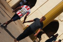 Michael Collett shakes hands with a fellow player while playing soccer football outside of Hassan II Mosque or Grande Mosquée Hassan II in Casablanca Morocco on Semester at Sea Photo Credit Zack Neher