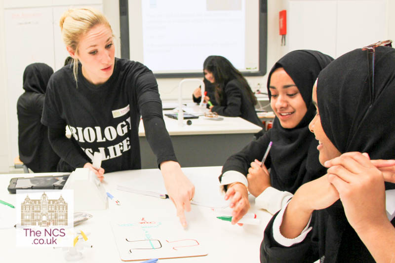 Teacher And Students In A Biology Lesson At Newham Collegiate Sixth Form Centre (The NCS)