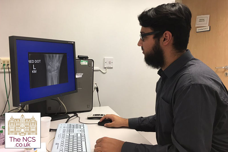 Newham Collegiate Sixth Form Centre (The NCS) Student Looks At X Ray On NHS Medical Hospital Work Experience