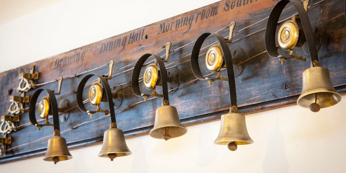 Wooden panel on which servants' bells are mounted with pull-cords attached