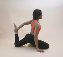 woman performing a yoga stretch