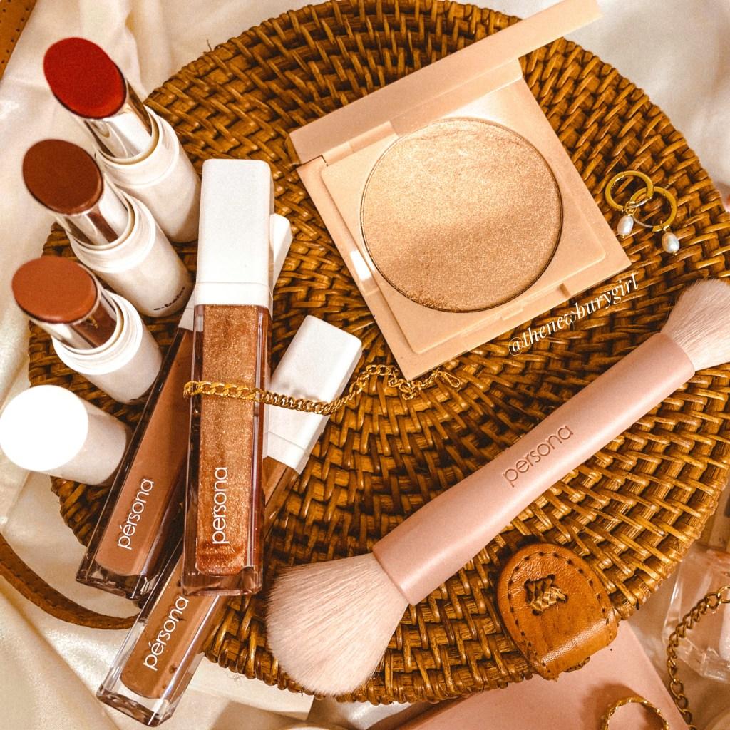 Persona Cosmetics Zuma Cali Glow Highlighter Review | A flatlay featuring the Persona e-Balms, Persona lip liners, Persona Paints, Persona Power Brush, etc