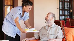 An elderly man in an assisted living facility