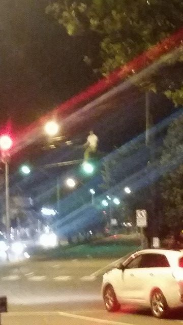 Newport Man On Traffic Light Beam 4