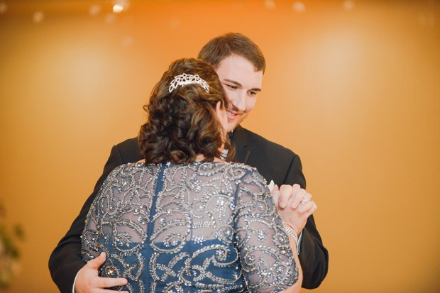 Danielle and Dan's gold and cranberry wedding has perfect clouds and lots of glittering gold