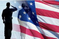Military service member saluting the U.S. flag