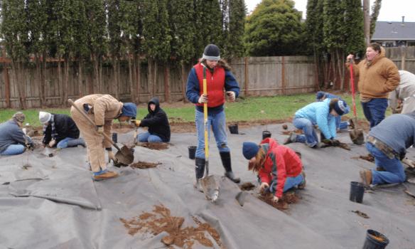 Volunteers building the demonstration garden.