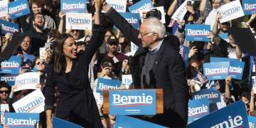 aoc,-michael-moore-pinch-hit-at-iowa-rally-with-bernie-sanders-in-dc-for-trump's-senate-impeachment-trial