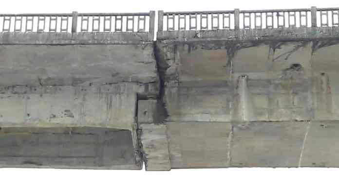 The image shared by Tony Pertin shows the crack on the Siang River bridge in Pasighat