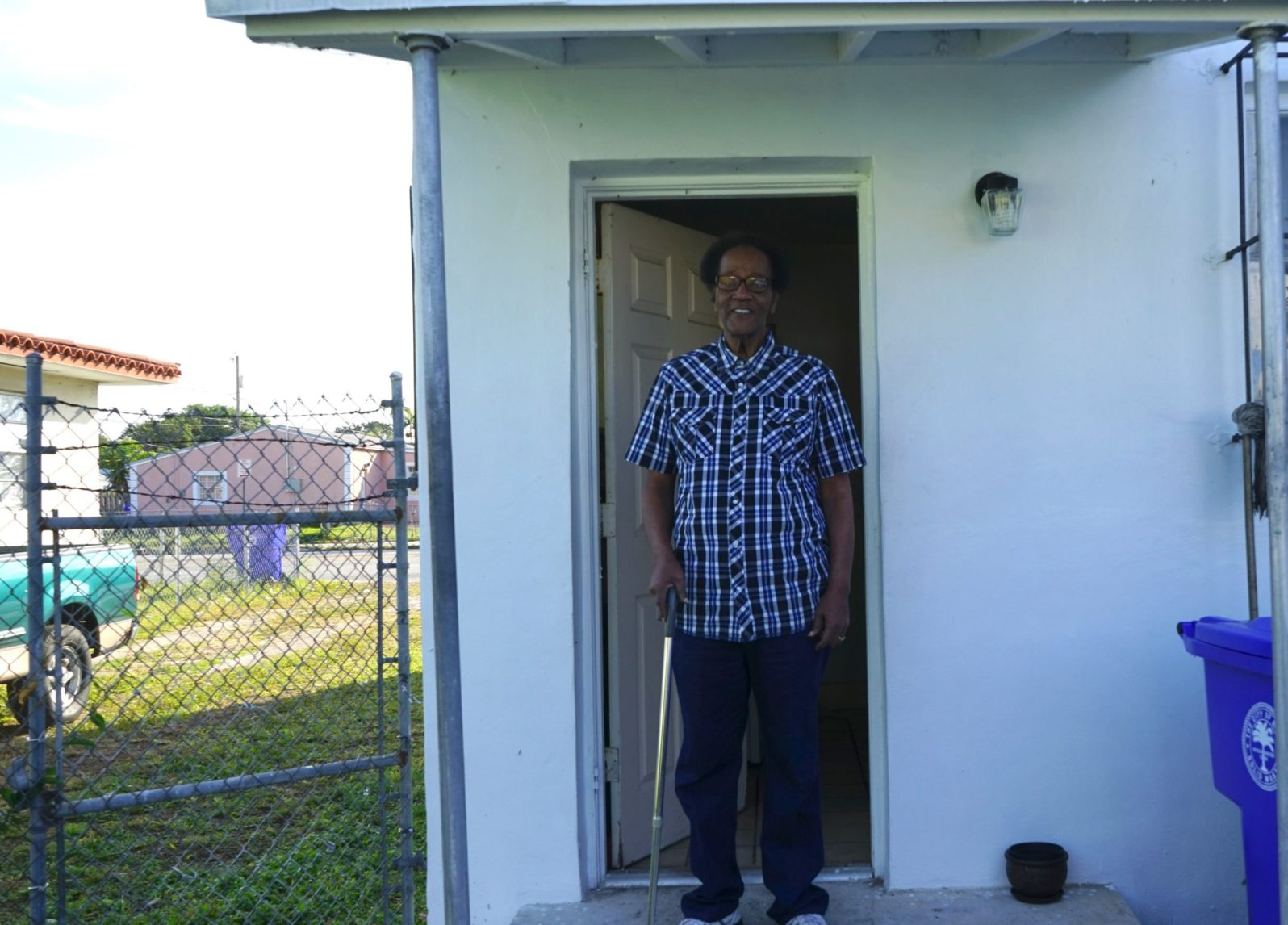 James Howard, Jr. lives in a quaint, two story white house in Liberty City. His daughter Bereatha wants to make sure he is prepared for climate change. (Credit: Roshan Nebhrajani/The New Tropic)