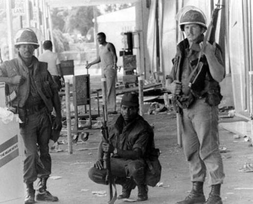 Guardsmen stand at a looted store during the McDuffie Riots in Liberty City. (Credit: State Archives of Florida)