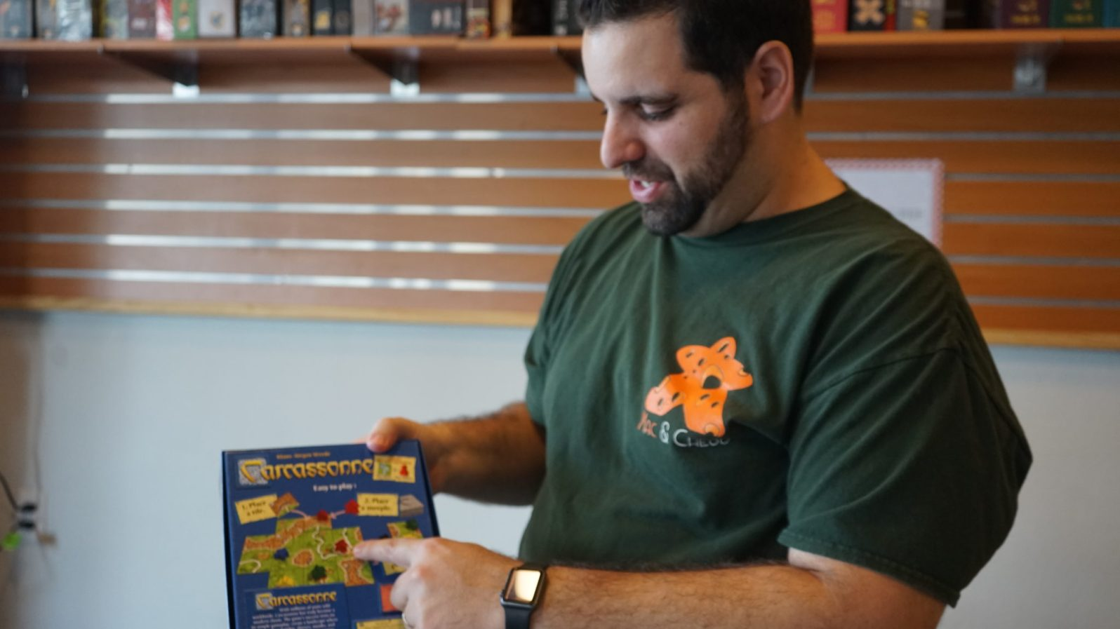 man explaining a board game, Carcassonne