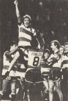 The 1982 Strikers hold up a buoyant Ray Hudson, future winning coach of the Miami Fusion. (nasljerseys.com photo)