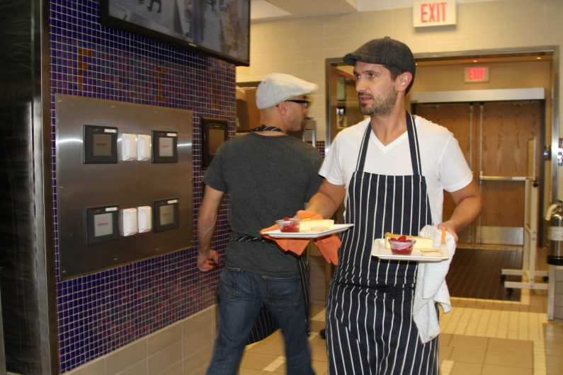 Andy Bates of The Avenue rushing through the kitchen.