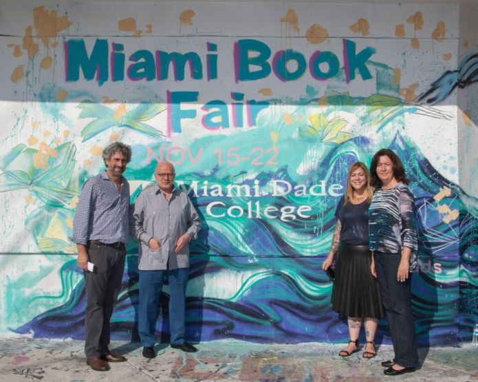 (Left to right) Mitchell Kaplan, Dr. Eduardo Padro, Lissette Mendez, and Delia Lopez at the Miami Book Fair mural.
