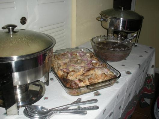 Lechón with red onions and Stefanie Delgado's grandmother's black beans. (Courtesy of Stefanie Delgado)