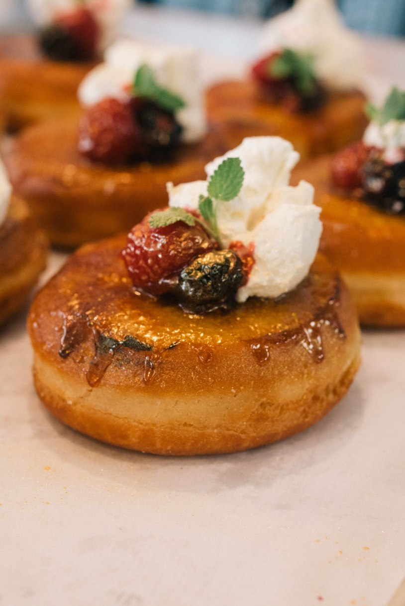 The eggnog Creme brûlée is a brioche scooped out and filled with a homemade eggnog custard that's torched to order and topped with a mascarpone whip cream and fresh berries. (Courtesy of The Salty Donut)