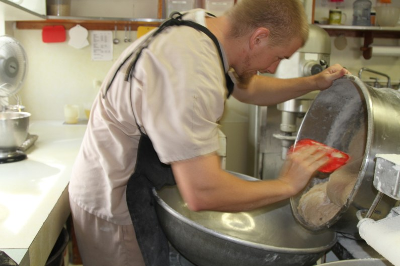 Dusty emptying the mixing bowl.