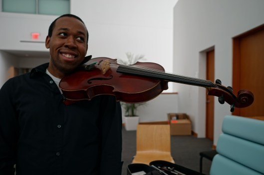 You don't actually have to hold it. There's a shoulder and chin rest for keeping the viola in place.
