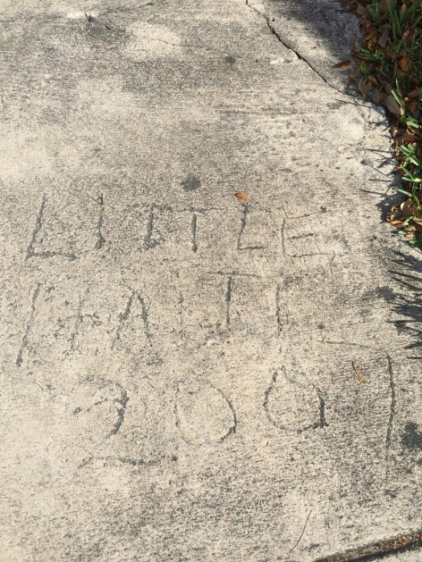 """Little Haiti 2007"" etched into the concrete near NW 63rd Ave. and NE 4th Ct."