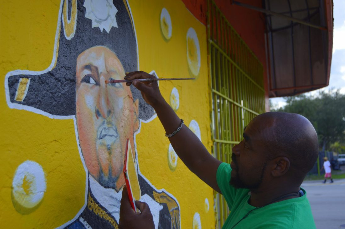 Artist and muralist Serge Toussaint painting Haitian Kreyol rap artist, poet, and producer Mecca, aka Grimo.