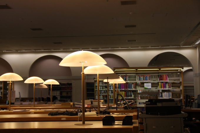 Lamps illuminate the reading room at the Downtown MDPL branch.